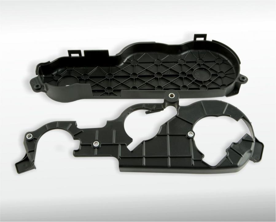 2K-Zahnriemenabdeckung mit eingespritzten Metallbuchsen