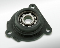 Bearing flange with in-moulded ball-bearings
