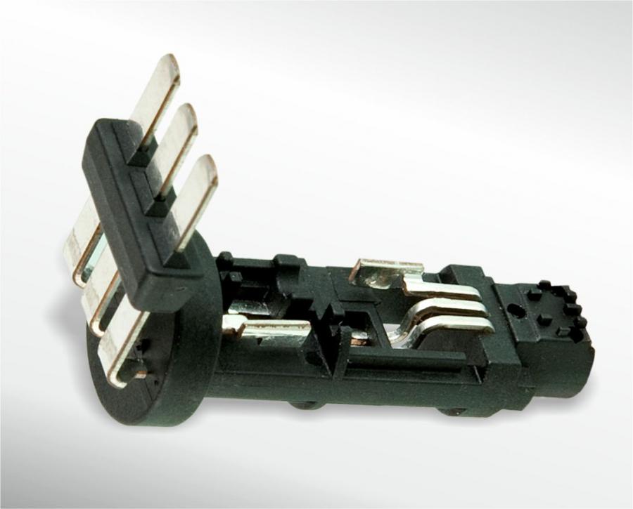 Elektronikbauteil mit eingespritzten Kontakten und Magnet