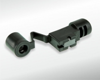Sensor with in-moulded solenoid
